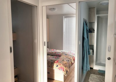 Wardrobe, parent's bedroom and a part of bathroom