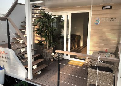Entrance deck of the floating house Ana